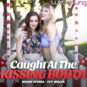 Publicity photo of Ivy Wolfe and Danni Rivers embracing at a classic kissing booth.